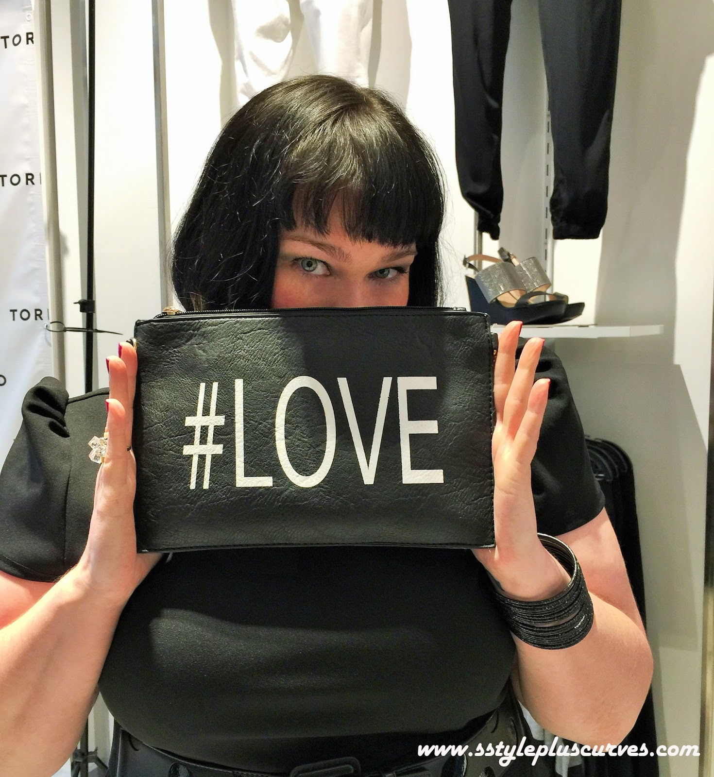 Amber from Style Plus Curves with the #Love Clutch at the Torrid in Chicago