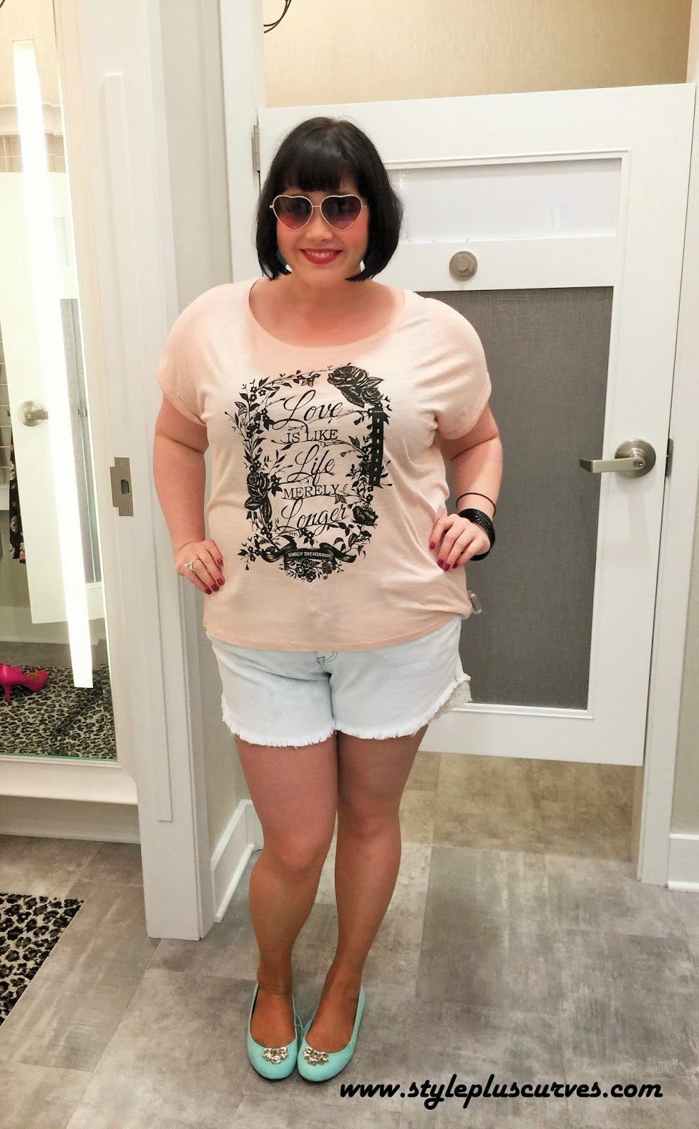 Amber from Style Plus Curves in a casual tshirt and jean shorts at the Torrid in Chicago