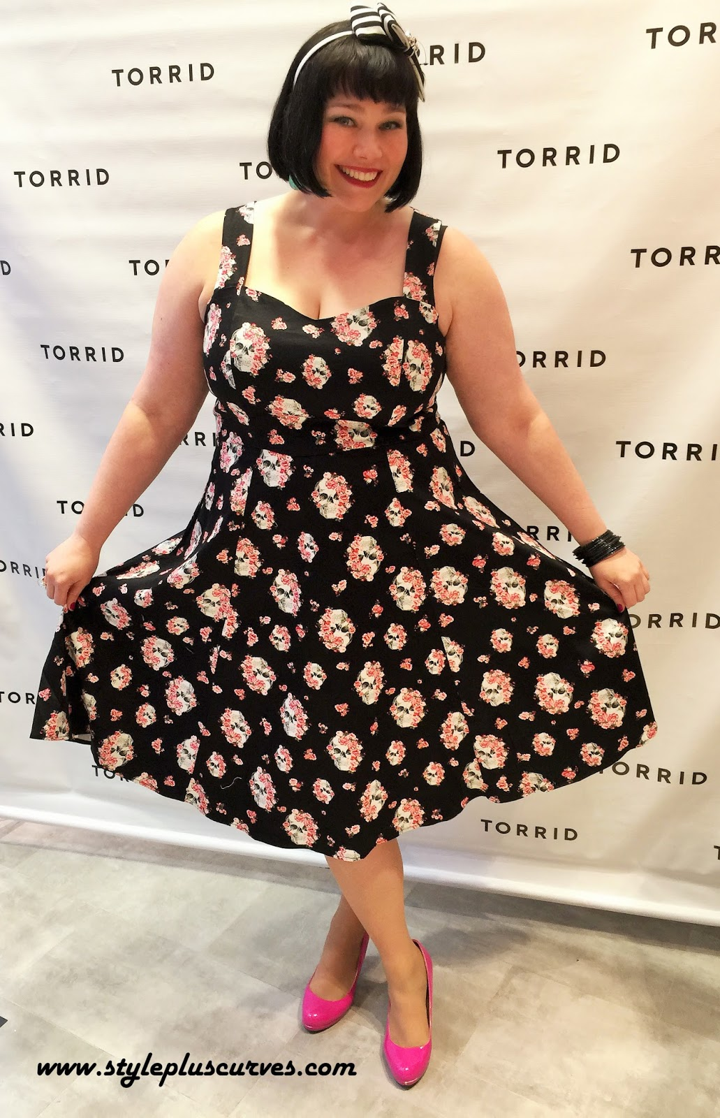 Amber from Style Plus Curves in the Floral Skull Swing Dress from Torrid at the Chicago Opening