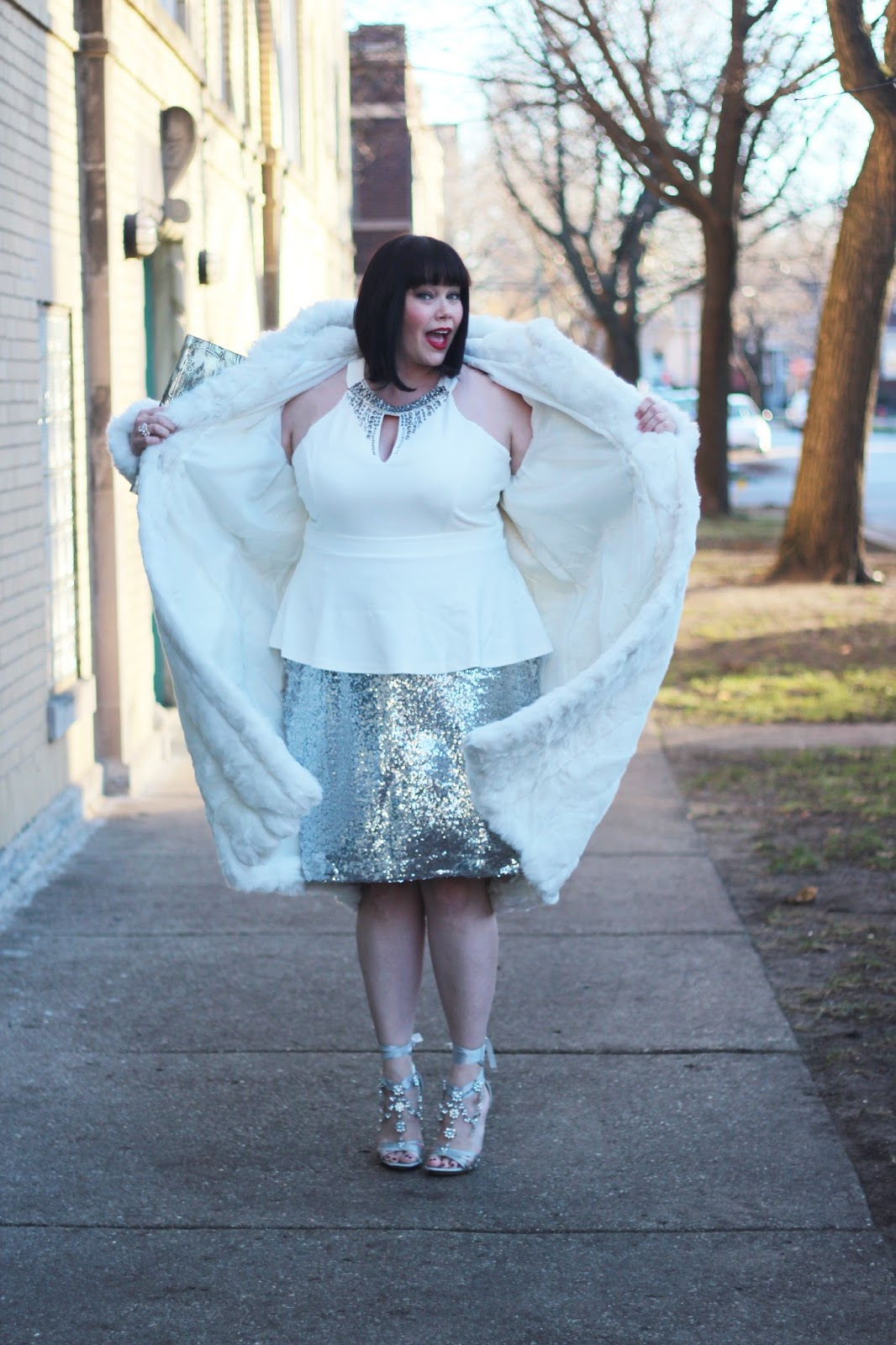 Amber from Style Plus Curves in a White Plus Size Faux Fur Coat, Sequin Skirt and White Peplum Top from Fullbeauty.com