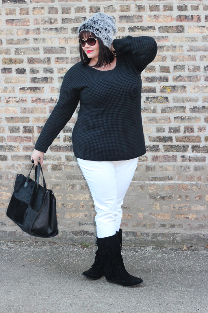 Plus Size Blogger Amber in plus size black sweater, plus size white skinny jeans, fur hat