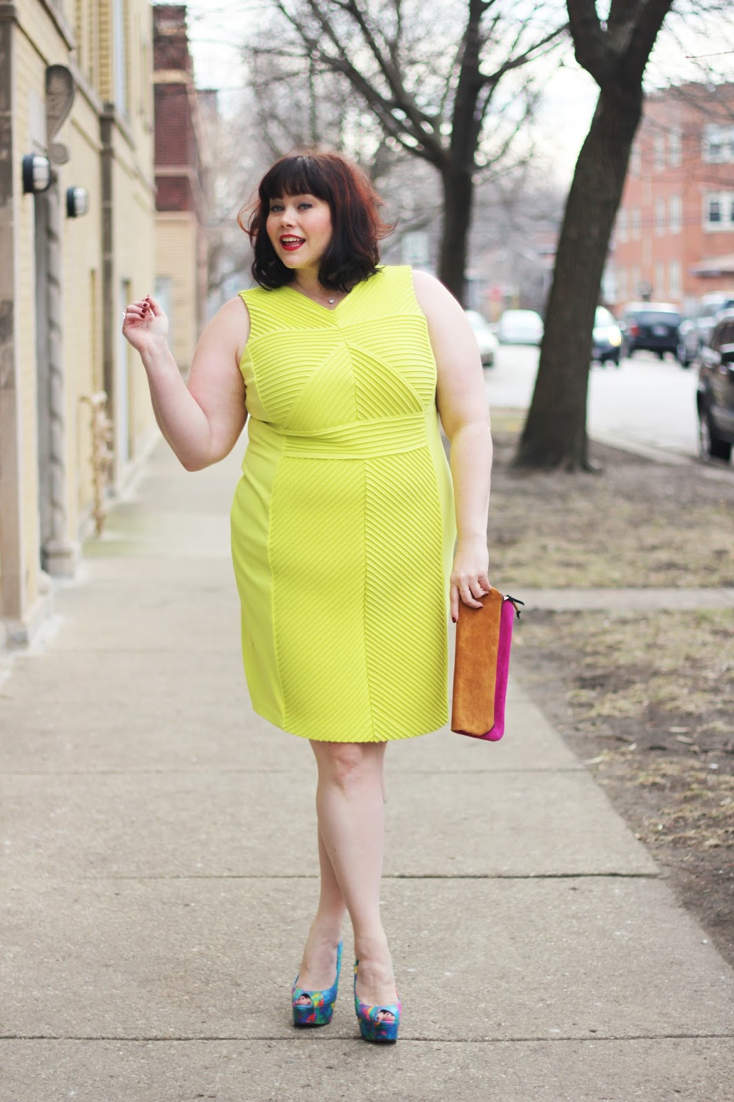 Plus Size Blogger Amber from Style Plus Curves in a bright yellow Calvin Klein Dress