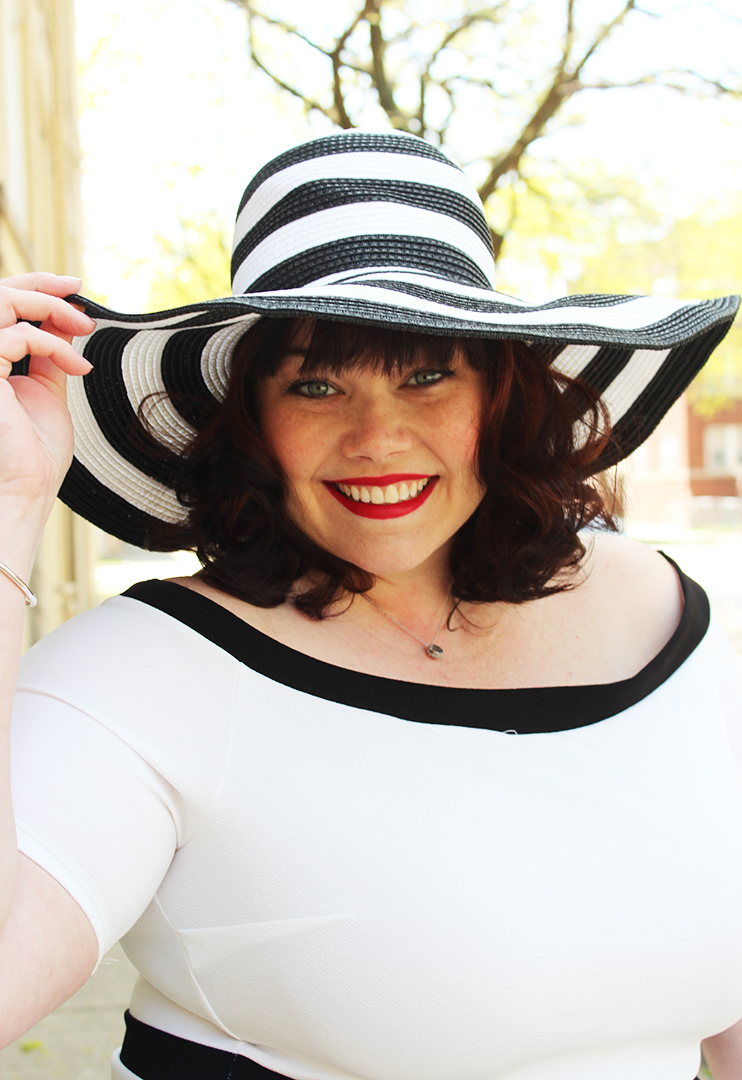 Plus Size Model Amber in a black and white striped wide brim hat from Fullbeauty.com