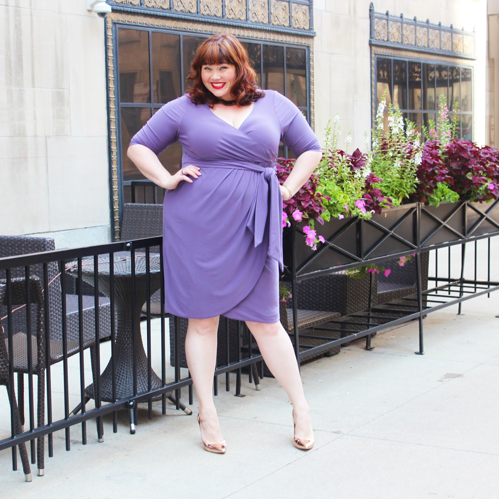 73878667c58f Plus Size Blogger Amber from Style Plus Curves models a lavender purple plus  size faux wrap