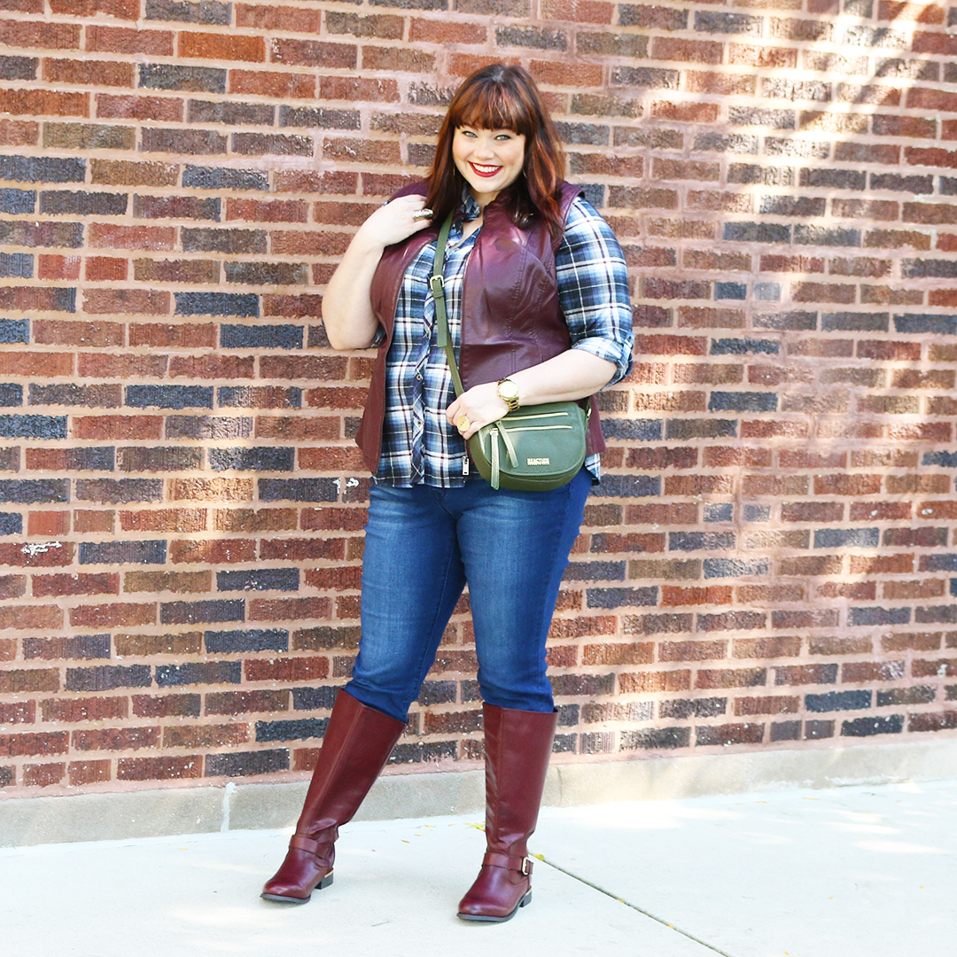 Chicago Plus Size Blogger Amber from Style Plus Curves in a Fall Outfit; Plaid top, skinny jeans, faux leather vest, leather boots, wine, burgundy
