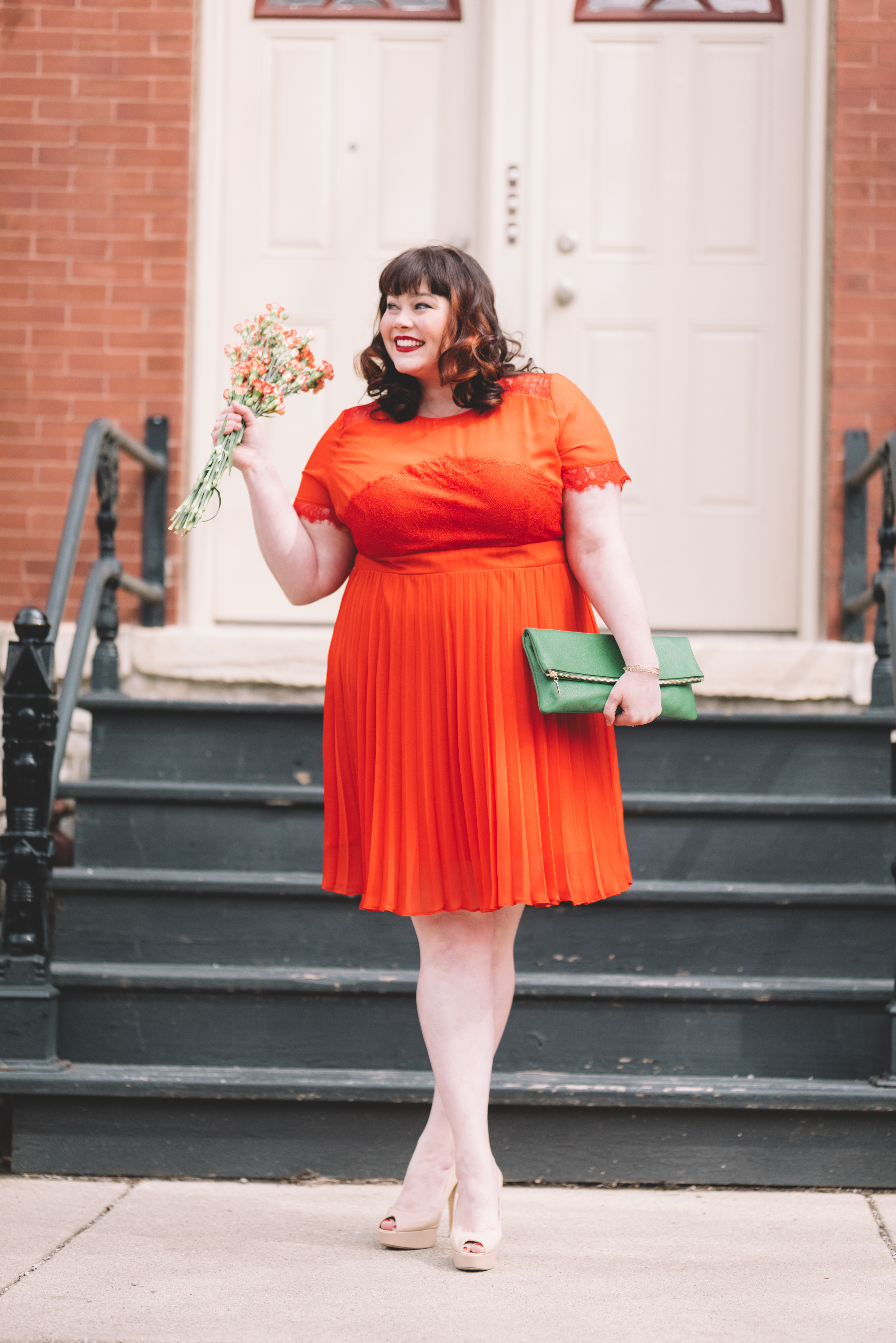 Plus Size blogger Style Plus Curves in an Orange dress and Green Custom Leather Bag from Laudi Vidni