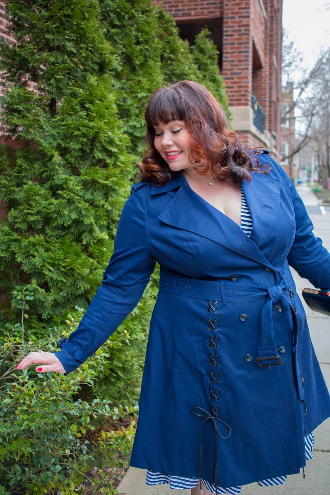 Chicago Plus Size Blogger in a navy lace up Trench Coat by Prabal Gurung from Lane Bryant