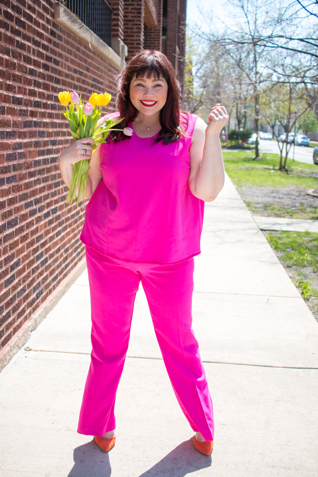 Plus Size Blogger wearing a pink suit from Victoria Beckham x Target collection