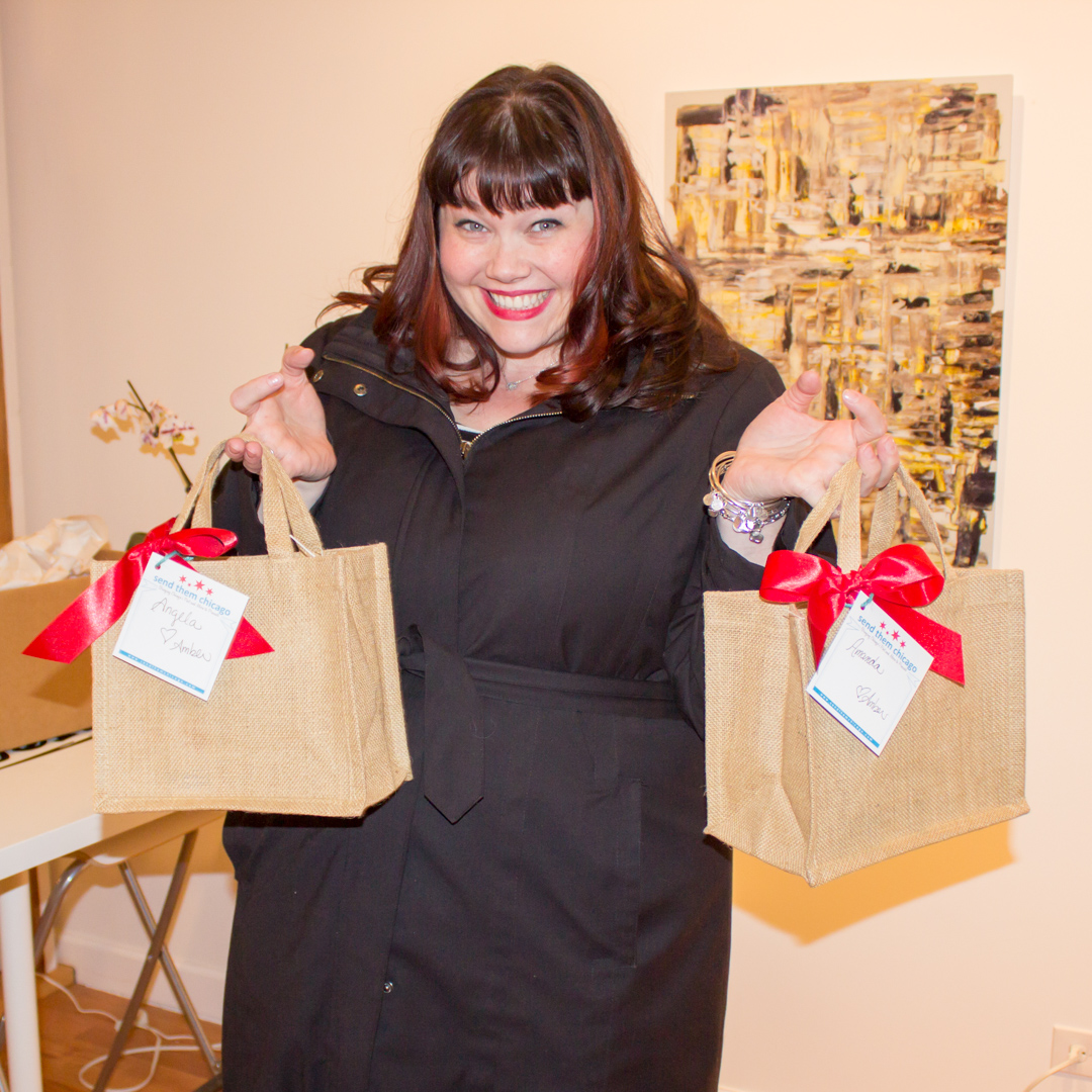 Chicago Blogger with a Chicago-themed gift basket from Send Them Chicago