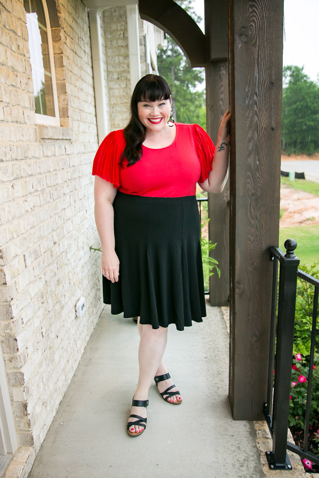 Plus Size Capsule Wardrobe, Avenue, Amber McCulloch, Style Plus Curves, Plus Size Blogger, Red Pleated Top, Black Swing Skirt, Travel Wardrobe