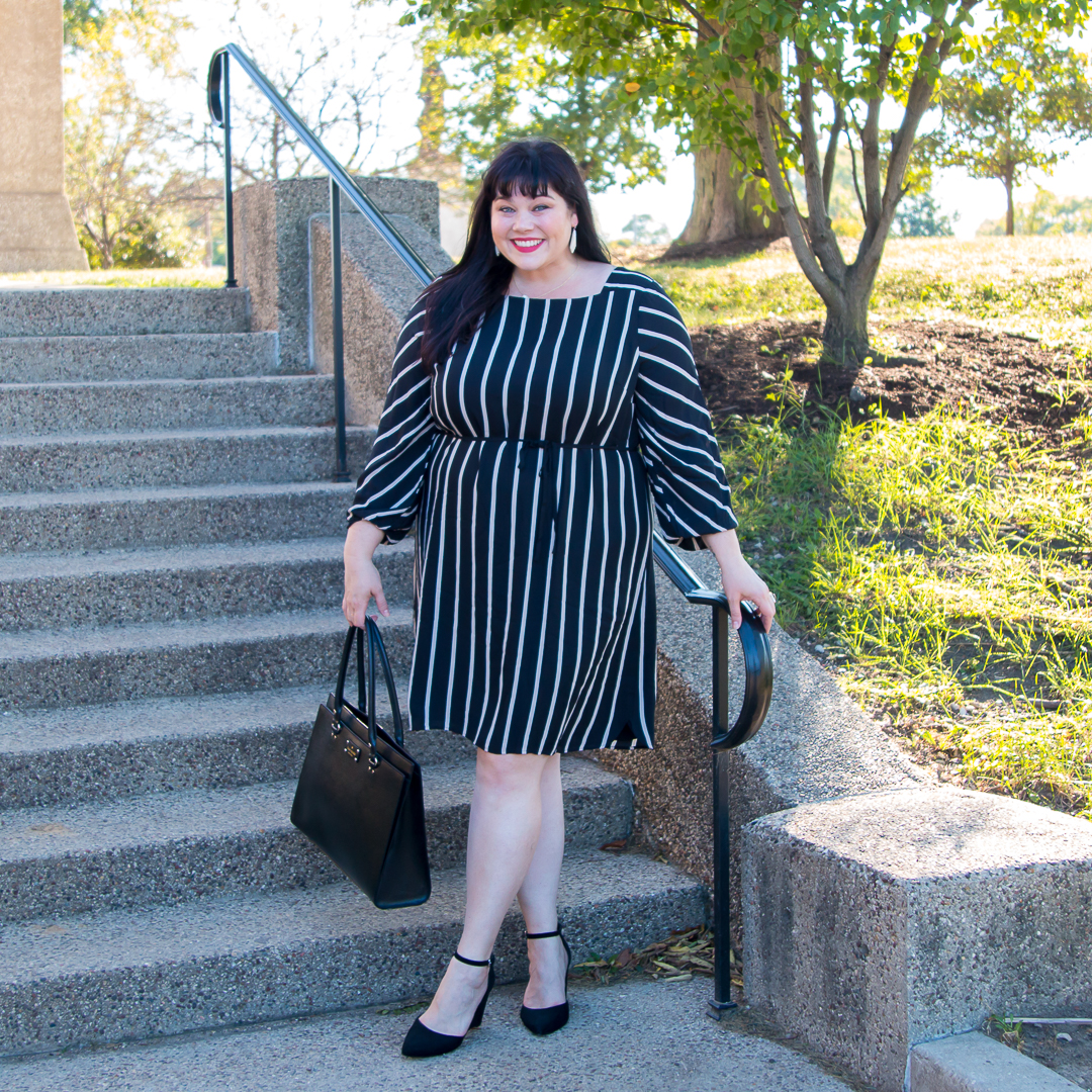 Plus Size Blogger wearing black striped dress from Loft Plus Size Collection