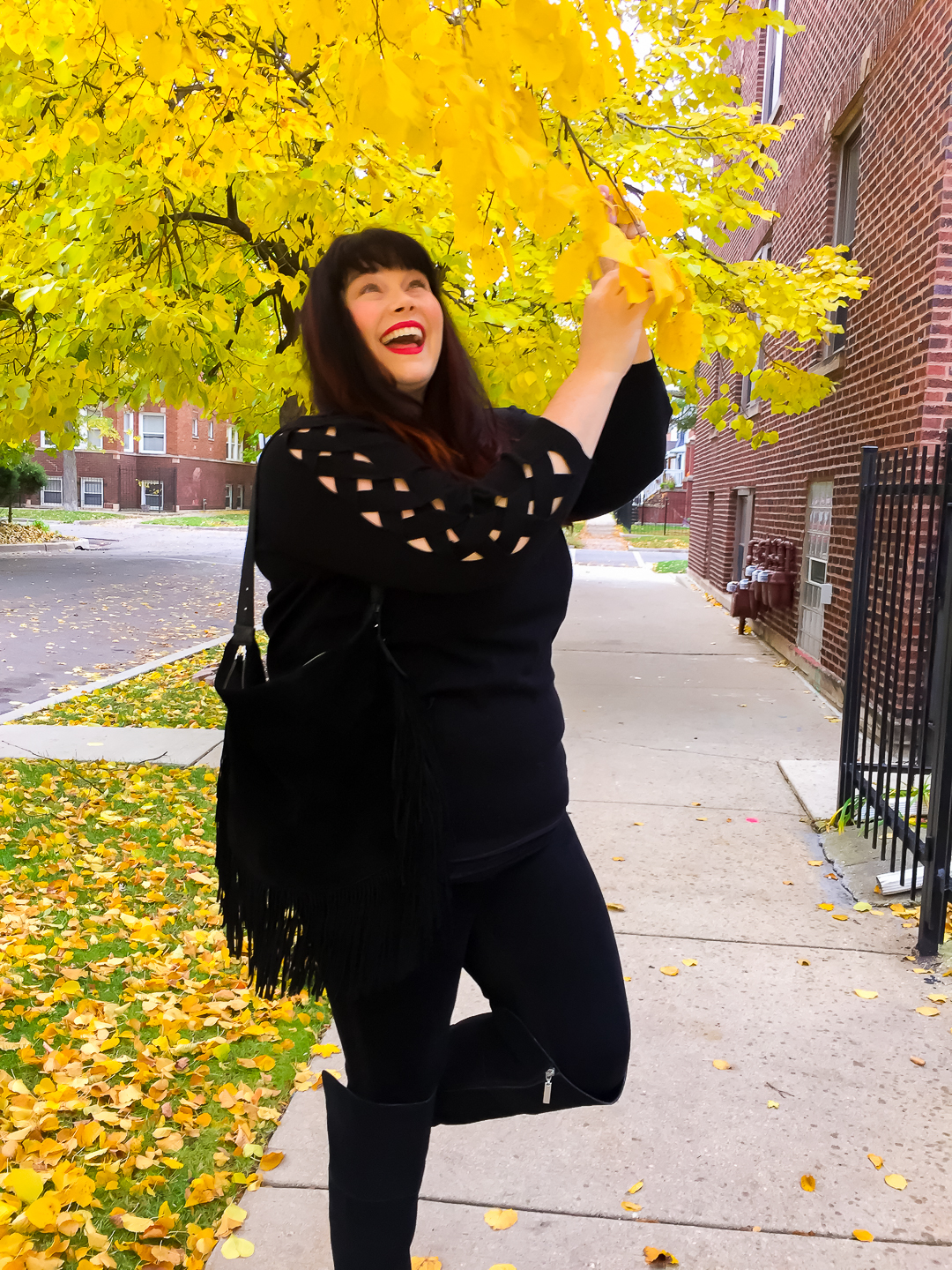 Chicago Blogger wears a black sweater with crosshatch design on sleeves